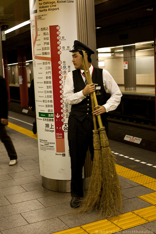 Cleaning the platform at a Tokyo metro station