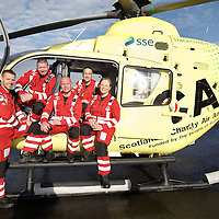 FREE TO USE PHOTOGRAPH....30.10.15<br /> Scotland's Charity Air Ambulance (SCAA) unveiled it's new helicopter at Perth airport this morning a EC135 T2i (pictured) which replaces the Bolkow 105 helicopter which is retiring from service. The new helicopter will increase speed, range, endurance and payload, allow SCAA to fly at night and in cloud. The Paramedic team from left, Mark Tynan, Craig McDonald, John Salmond, Lead Paramedic John Pritchard and Julia Barnes<br /> for further info please contact Maureen Young on 07778 779000<br /> Picture by Graeme Hart.<br /> Copyright Perthshire Picture Agency<br /> Tel: 01738 623350  Mobile: 07990 594431