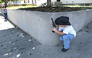 As the Benton Franklin County Fair and Rodeo nears, Reece Driver, 6,  right, is suited up for a game of cowboys with his hat, boots and cap gun in hand as he sneaks a peek around the corner at his younger brother Adrian, 5, outside their home Thursday, Aug. 17, 2006 in Richland, Wash.