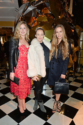 Left to right, KAT MANCHIP, ELLIE SHEPHERD and HUM FLEMING at a party to celebrate theunveiling of the Claridge's Christmas Tree designed by Christopher Bailey for Burberryheld at Claridge's, Brook Street, London on 18th November 2015.