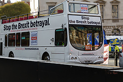 "A bus emblazoned with Leave Means Leave slogans demands ""Stop the Brexit Betrayal"" as some Leave supporters interpret recent events in Parliament as a betrayal of the 'will of the people' as MPs thwart attempts by the government to sell the deal Prime Minister Theresa May negotiated. London, January 14 2019."