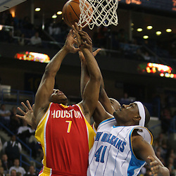 Jan 02, 2010; New Orleans, LA, USA; Houston Rockets guard Kyle Lowry (7) and New Orleans Hornets forward James Posey (41) battle for a rebound during the second quarter at the New Orleans Arena. Mandatory Credit: Derick E. Hingle-US PRESSWIRE