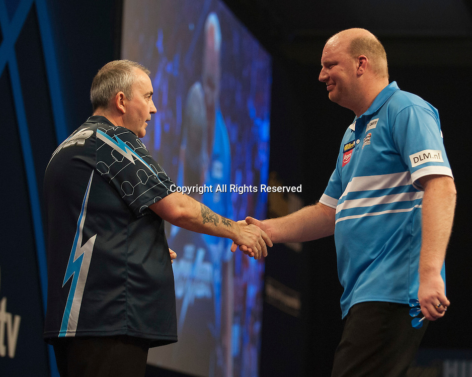 02.01.2014.  London, England.  William Hill PDC World Darts Championship.  Quarter Final Round.  Vincent van der Voort (23) [NED] shakes hands with Phil Taylor (2) [ENG] after their  match.  Phil Taylor won the match 5-3