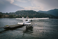 COMO, ITALY - 21 JUNE 2017: A seaplane is seen here of the Lake Como as it is prepared to take off, in Como, Italy, on June 21st 2017.<br /> <br /> Residents of Como are worried that funds redirected to migrants deprived the town's handicapped of services and complained that any protest prompted accusations of racism.<br /> <br /> Throughout Italy, run-off mayoral elections on Sunday will be considered bellwethers for upcoming national elections and immigration has again emerged as a burning issue.<br /> <br /> Italy has registered more than 70,000 migrants this year, 27 percent more than it did by this time in 2016, when a record 181,000 migrants arrived. Waves of migrants continue to make the perilous, and often fatal, crossing to southern Italy from Africa, South Asia and the Middle East, seeing Italy as the gateway to Europe.<br /> <br /> While migrants spoke of their appreciation of Italy's humanitarian efforts to save them from the Mediterranean Sea, they also expressed exhaustion with the country's intricate web of permits and papers and European rules that required them to stay in the country that first documented them.