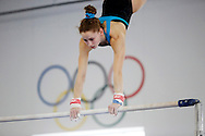 Rachel Gowey, 18, of Urbandale practices on the high bar Tuesday, April 19, 2016, as Gowey prepares for national competitions and a shot at the Olympic trials at Chow's Gymnastics and Dance in West Des Moines. The uneven bar is one of Gowey's strengths in the gym and could be key in getting a spot on the US Olympic team.