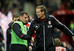 STOKE-ON-TRENT, ENGLAND - Boxing Day Wednesday, December 26, 2012: Liverpool's Jamie Carragher and Stoke City's Peter Crouch before the Premiership match at the Britannia Stadium. (Pic by David Rawcliffe/Propaganda)