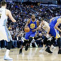 13 February 2017: Golden State Warriors forward Kevin Durant (35) drives past Denver Nuggets forward Juancho Hernangomez (41) on a screen set by Golden State Warriors center JaVale McGee (1) during the Denver Nuggets 132-110 victory over the Golden State Warriors, at the Pepsi Center, Denver, Colorado, USA.