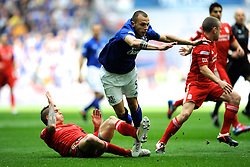 John Heitinga of Everton is tackled by Daniel Agger of Liverpool during the Budweiser FA Cup semi final match between Liverpool and Everton at Wembley on Saturday 14 April 2012 (Photo by Rob Munro)