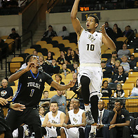 ORLANDO, FL - DECEMBER 31:  Adonys Henriquez #10 of the UCF Knights shoots the ball during an NCAA basketball game against the Tulsa Golden Hurricane at the CFE Arena on December 31, 2014 in Orlando, Florida. (Photo by Alex Menendez/Getty Images) *** Local Caption *** Adonys Henriquez