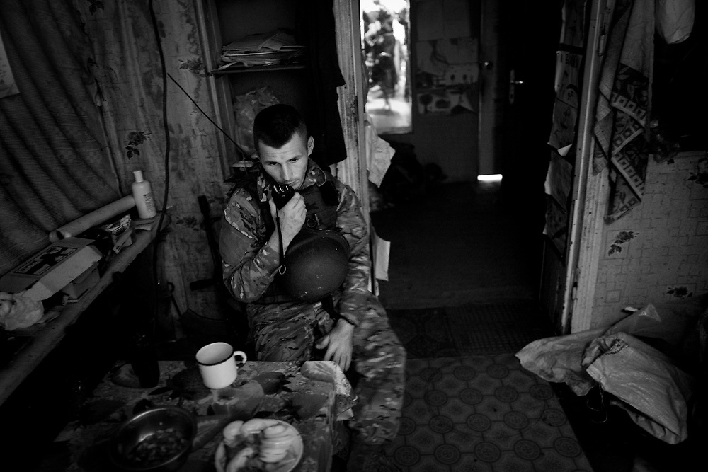 In Maryinka the shooting never really stops. The worst part is during darkness. Lieutenant Maxim stays in touch with the rest of his troops from one of the positions.