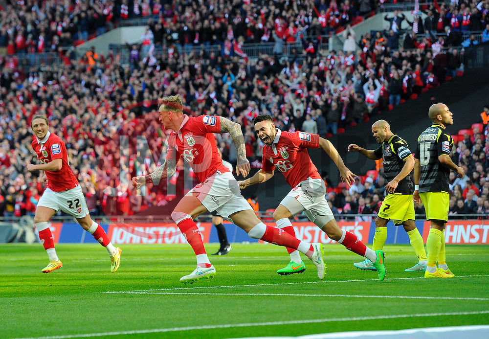 Bristol City's Aden Flint celebrates scoring the opening goal of the game  - Photo mandatory by-line: Joe Meredith/JMP - Mobile: 07966 386802 - 22/03/2015 - SPORT - Football - London - Wembley Stadium - Bristol City v Walsall - Johnstone Paint Trophy Final