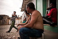 Men play a game of baseball with a stick in Trinidad street, on Thursday, April 24, 2008...When music and dancing are the rhythm and soul of life on this island nation, baseball is the passion. It gives Cubans something to dance to and something to cheer for when there's little else. It's what makes them feel free of government politics.