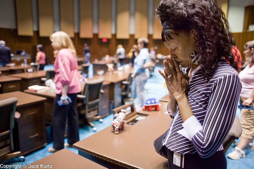 07 MAY 2009 -- PHOENIX, AZ: Geneva Johnson-Joksch (CQ) from Phoenix, prays at the capitol during the National Day or Prayer services at the State Capitol in Phoenix Thursday. About 30 people came to the capitol to pray for government officials at the desks of legislators.   Photo by Jack Kurtz