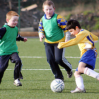 Newtown's Sean Hanly tries to get past Moneypoint's Emmet McCall and Gary Roche during a soccer blitz at Lees Road on Saturday morning.<br /> <br /> Photograph by Yvonne Vaughan.