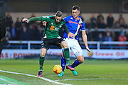Kevin Van Veen challenged by Harrison McGahey during the EFL Sky Bet League 1 match between Rochdale and Scunthorpe United at Spotland, Rochdale, England on 10 December 2016. Photo by Daniel Youngs.