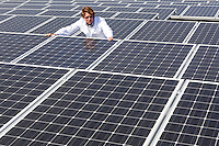 Man surveying solar panels