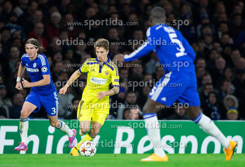 Filipe Luís of Chelsea and Luka Zahovic of Maribor during football match between Chelsea FC and NK Maribor, SLO in Group G of Group Stage of UEFA Champions League 2014/15, on October 21, 2014 in Stamford Bridge Stadium, London, Great Britain. Photo by Vid Ponikvar / Sportida.com