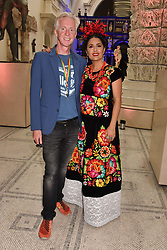 "Philip Treacy and Salma Hayek at the opening of ""Frida Kahlo: Making Her Self Up"" Exhibition at the V&A Museum, London England. 13 June 2018."