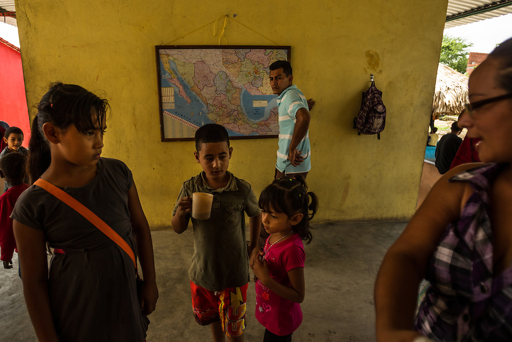 TENOSIQUE, MEXICO - JULY 2, 2014:  Undocumented migrants near a map of Mexico  at the 72 migrant shelter in Tenosique. Even without official permission to stay, many migrants find an extensive system of church and nonprofit-run shelters helping them and making the journey north possible. PHOTO: Meridith Kohut for The New York Times