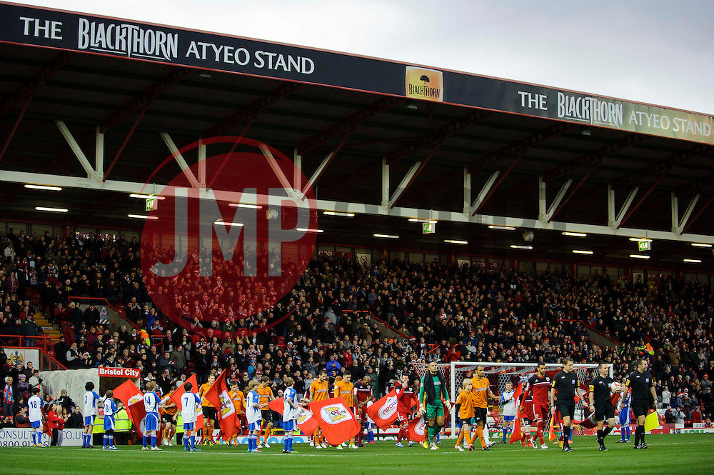 The two sides walk out onto the pitch before the first half of the match - Photo mandatory by-line: Rogan Thomson/JMP - Tel: Mobile: 07966 386802 01/12/2012 - SPORT - FOOTBALL - Ashton Gate - Bristol. Bristol City v Wolverhampton Wanderers - npower Championship.