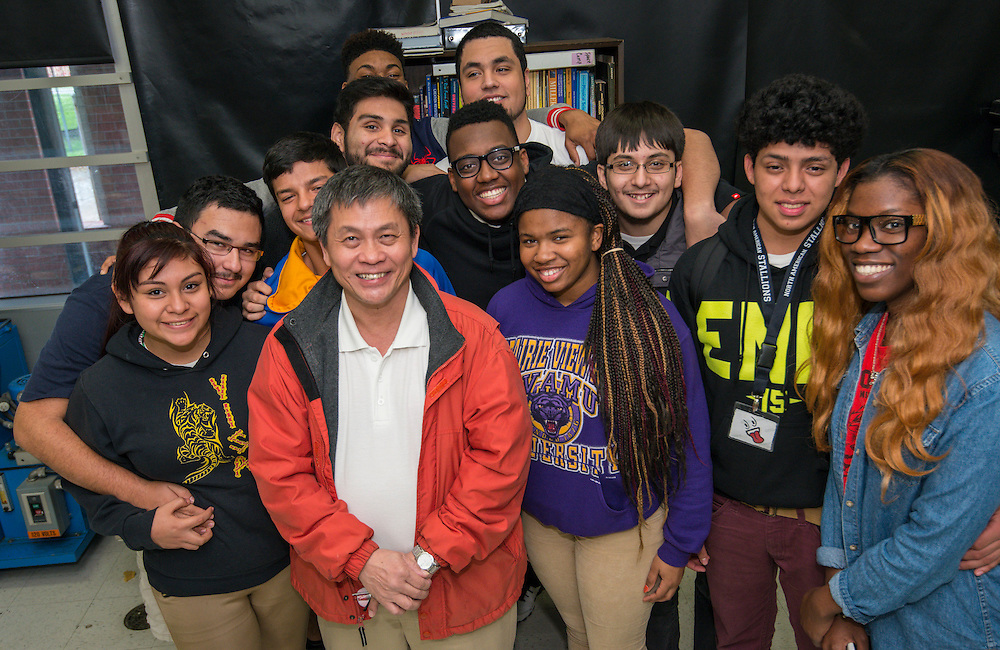 Dr. Nghia Le poses for a photograph with some of his students after being recognized as a finalist in the 2015 HEB Excellence in Education Awards at Washington High School, March 12, 2015.
