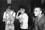Neville, Nicky, Sym at a gig. UK. 1980s.