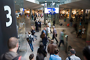Blurred motion image showing movement of people at  Rotterdam Centraal railway station, Rotterdam, Netherlands