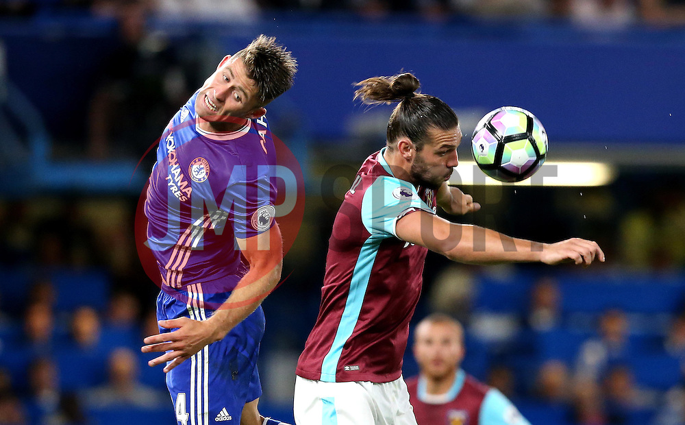 Andy Carroll of West Ham United beats Gary Cahill of Chelsea to the ball - Mandatory by-line: Robbie Stephenson/JMP - 15/08/2016 - FOOTBALL - Stamford Bridge - London, England - Chelsea v West Ham United - Premier League