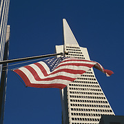 USA flag and Trans America building against blue sky, San Francisco, California
