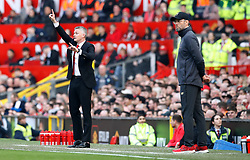 Manchester United caretaker manager Ole Gunnar Solskjaer (left) gestures on the touchline during the Premier League match at Old Trafford, Manchester.