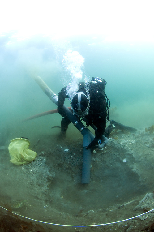 Diving archeologist at work. Location : Avaldsnes, Norway