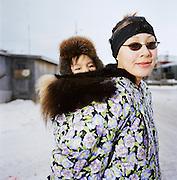 Mother and baby in Kivalina, Alaska. 2007