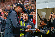 Liverpool manager Jurgen Klopp signing autographs for football fans, football supporters before the EFL Cup match between Milton Keynes Dons and Liverpool at stadium:mk, Milton Keynes, England on 25 September 2019.