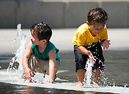 Children cool down themselves at a fountain on Tuesday, Aug. 29, 2017, in Los Angeles. Record-breaking heat will persist across Southern California today, with L.A. County temperatures up to 18 degrees above normal, and forecasters issued a heat advisory for the L.A. County coast. ``The combination of strong high pressure and weak onshore flow will continue to produce dangerously hot temperatures across the region through at least the end of the week and possibly into the Labor Day weekend,'' according to a National Weather Service statement.(Photo by Ringo Chiu)<br /> <br /> Usage Notes: This content is intended for editorial use only. For other uses, additional clearances may be required.
