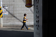 Daegu/South Korea, Republic Korea, KOR, 03.10.2009: Boy on the street of the South Korean city Daegu.
