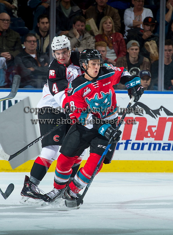 KELOWNA, CANADA - OCTOBER 28: Joel Lakusta #4 of the Prince George Cougars back checks Leif Mattson #28 of the Kelowna Rockets during first period on October 28, 2017 at Prospera Place in Kelowna, British Columbia, Canada.  (Photo by Marissa Baecker/Shoot the Breeze)  *** Local Caption ***