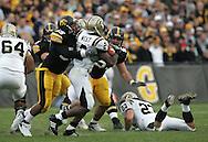 17 NOVEMBER 2007: Western Michigan running back Brandon West (2) is hit by Iowa linebacker Jacody Coleman (55) in Western Michigan's 28-19 win over Iowa at Kinnick Stadium in Iowa City, Iowa on November 17, 2007.
