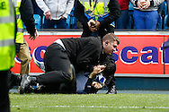 A fan is forceably removed from the pitch after the Sky Bet Championship match at The Den, London<br /> Picture by David Horn/Focus Images Ltd +44 7545 970036<br /> 03/05/2014