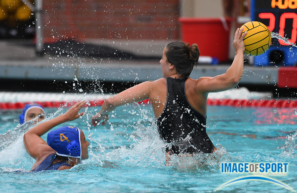 Pacific Tigers attacker Mariana Duarte (5) is defended by UCLA Bruins defender Rachel Whitelegge (4) during an NCAA college women's water polo quarterfinal game in Los Angeles, Friday, May 11, 2018. UCLA defeated Pacific, 8-4.