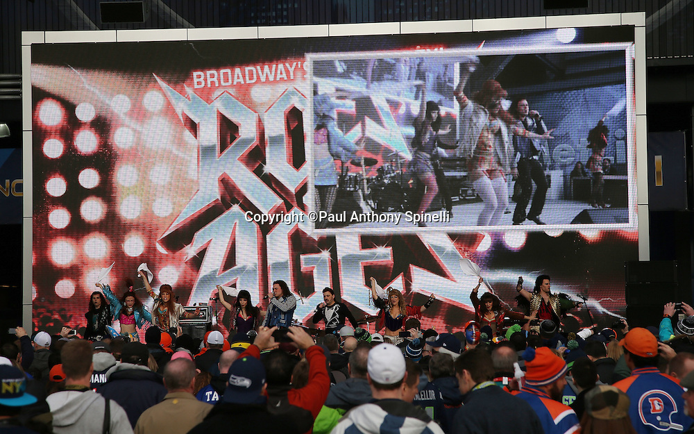 Fans watch a performance of the Broadway Musical Rock of Ages outside the stadium before the NFL Super Bowl XLVIII football game between the Seattle Seahawks and the Denver Broncos on Sunday, Feb. 2, 2014 in East Rutherford, N.J. The Seahawks won the game 43-8. ©Paul Anthony Spinelli