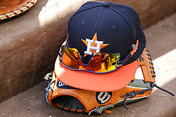 March 29, 2018 - Arlington, TX, U.S. - ARLINGTON, TX - MARCH 29: A Houston Astros hat and glove sits during the game between the Texas Rangers and the Houston Astros on March 29, 2018 at Globe Life Park in Arlington, Texas. Houston defeats Texas 4-1. (Photo by Matthew Pearce/Icon Sportswire) (Credit Image: © Matthew Pearce/Icon SMI via ZUMA Press)