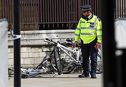 © Licensed to London News Pictures. 14/08/2018. LONDON, UK. Bicycles which were knocked down during a car crash incident outside the Houses of Parliament.  It is reported that two people were taken to hospital with non life threatening injuries.  A man has been arrested and investigations are ongoing.  Photo credit: Stephen Chung/LNP
