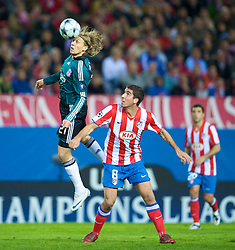 MADRID, SPAIN - Wednesday, October 22, 2008: Liverpool's Lucas Leiva and Club Atletico de Madrid's Raul Garcia during the UEFA Champions League Group D match at the Vicente Calderon. (Photo by David Rawcliffe/Propaganda)
