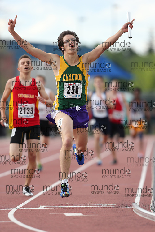 Jordan Sherwood of Cameron Heights CI - Kitchener competes in the celebrates victory in the 4x400m relay, clinching the overall team championship at the 2013 OFSAA Track and Field Championship in Oshawa Ontario, Thursday,  June 6, 2013.<br /> Mundo Sport Images / Sean Burges