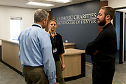 DENVER, CO - AUGUST 24: Fr. Scott Bailey (R) speaks with other attendees of the grand opening event at the Samaritan House Women's Shelter on August 24, 2017, in Denver, Colorado. (Photo by Anya Semenoff/for Catholic Charities)