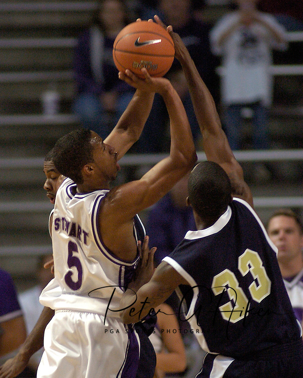 Kansas State guard Clent Stewart (R) has his shot blocked by Georgia Southern's Jarek Swain (33), during the first half of the Wildcats 83-58 win over the Eagles at Bramlage Coliseum in Manhattan, Kansas, November 19, 2005.