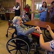 MANASSAS, VA - NOV21:  Consuela Rivera, 88, dances in her wheelchair with activity aide Tina Burhans-Robinson, during karaoke at Birmingham Green, an elder care residence in Manassas, VA, November 21, 2014. With the U.S. population aging and Alzheimer's more widespread, science is looking for ways to slow or delay the onset of dementia in aging Americans. Among the approaches is trying to determine whether art, music and dance or movement can also alleviate the problems attendant with dementia. The federal government is funding a study at Birmingham Green with George Mason University to see whether there is a scientific basis to believe that art is actually medically beneficial. (Photo by Evelyn Hockstein/For The Washington Post)