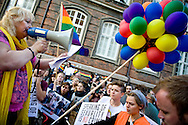 20.09.2013. Copenhagen, Denmark.10.000 people marched to the Russian Embassy in Copenhagen in protest against the Russian gay law. One of the founders of the association Lavalie Medea speak during the demonstration outside the Russian Embassy.Photo: © Ricardo Ramirez