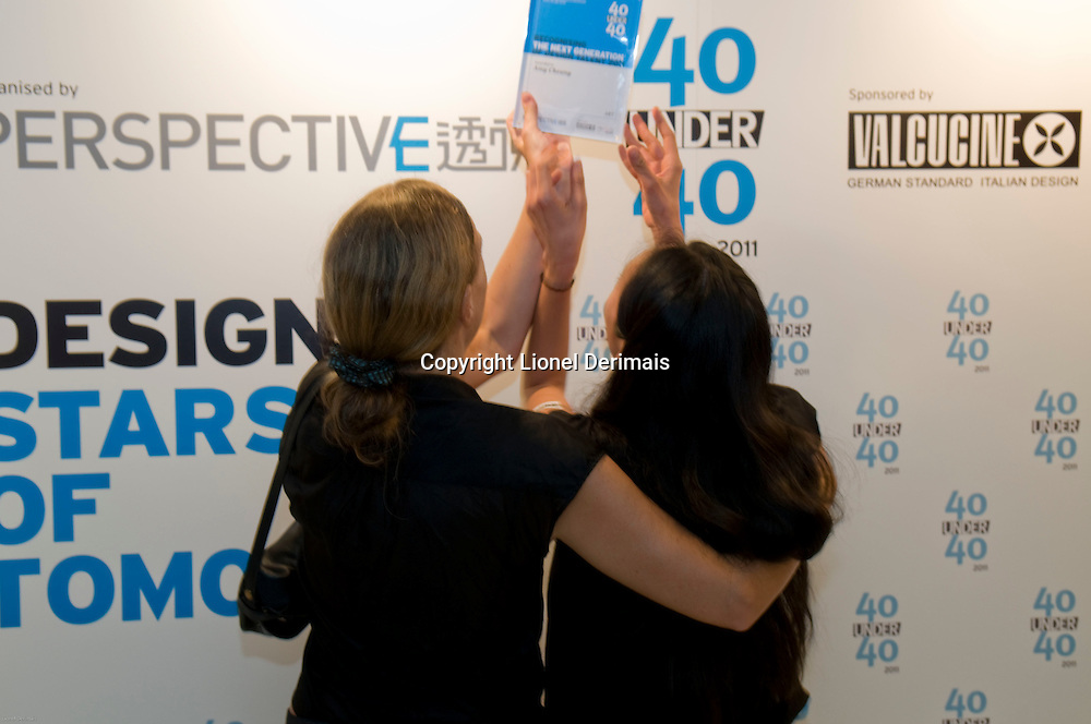 Picture shy Hong Kong artist Amy Cheung (R) receives her 40 Under 40 Perspective magazine award.