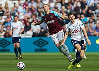Football - 2017 / 2018 Premier League - West Ham United vs Tottenham Hotspur<br /> <br /> Ben Davies (Tottenham FC)  fouls Marko Arnautovic (West Ham United) at the London Stadium<br /> <br /> COLORSPORT/DANIEL BEARHAM